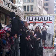 Singing on the U-Haul float in the Veterans' Day Parade