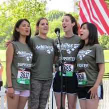 Singing the National Anthem to start the Achilles Hope and Possibility 5-miler